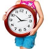 Niña con el reloj Fotografía de archivo libre de regalías