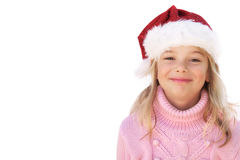 Niña con el sombrero de Santa en el fondo blanco Fotografía de archivo libre de regalías