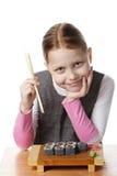 Niña con el sushi Fotografía de archivo