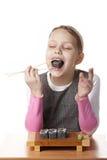 Niña con el sushi Imagen de archivo libre de regalías