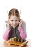 Niña con el sushi Imagenes de archivo