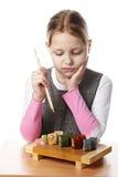 Niña con el sushi Imagen de archivo