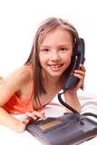 Niña con el teléfono Fotografía de archivo libre de regalías