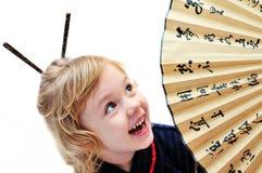 Niña con el ventilador Foto de archivo libre de regalías