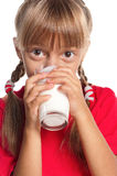 Niña con el vidrio de leche Fotos de archivo