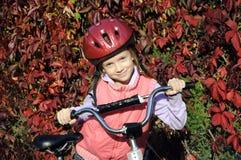 Niña con la bicicleta Imagenes de archivo