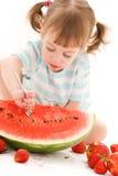 Niña con la fresa y la sandía Fotografía de archivo