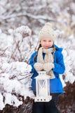 Niña con la linterna de la Navidad Imagen de archivo
