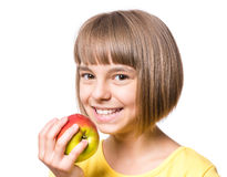 Niña con la manzana Foto de archivo