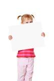 Niña con la tarjeta blanca Fotos de archivo libres de regalías