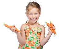 Niña con la zanahoria Imagen de archivo