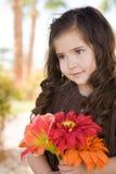 Niña con las flores Foto de archivo libre de regalías