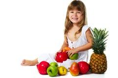 Niña con las frutas Fotografía de archivo