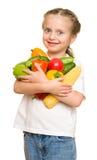Niña con las frutas y verduras en blanco Imagen de archivo