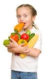 Niña con las frutas y verduras en blanco Fotografía de archivo