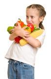 Niña con las frutas y verduras en blanco Imagen de archivo libre de regalías