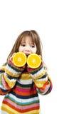 Niña con las naranjas Imagen de archivo libre de regalías