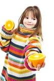 Niña con las naranjas Fotos de archivo libres de regalías