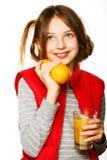 Niña con las naranjas y el jugo Foto de archivo