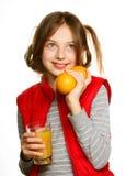 Niña con las naranjas y el jugo Fotografía de archivo