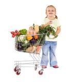 Niña con las tiendas de comestibles Imagenes de archivo