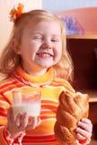 Niña con leche Imagen de archivo