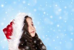 Niña con los copos de nieve Imágenes de archivo libres de regalías