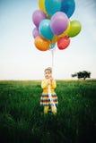 Niña con los globos coloridos Foto de archivo libre de regalías