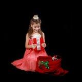 Niña con los regalos Imagen de archivo