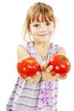 Niña con los tomates Fotos de archivo