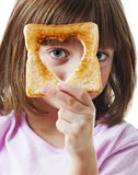 Niña con pan Imagen de archivo