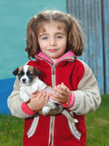 Niña con su animal doméstico Imagen de archivo