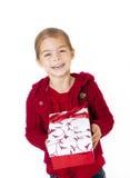 Niña con su regalo de Navidad Fotos de archivo