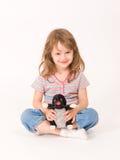 Niña con un juguete de la felpa Imagen de archivo libre de regalías