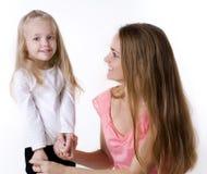 niña con una madre Imagenes de archivo