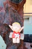 Niña de la muñeca en un oscilación Foto de archivo libre de regalías