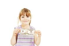 Niña del dinero del dólar que muestra la cuenta de dólar 50. Imagen de archivo