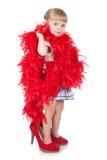 Niña divertida en una boa roja Imagen de archivo libre de regalías