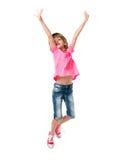 Niña en el salto rosado aislada en el fondo blanco Fotografía de archivo