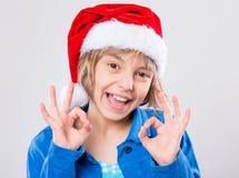 Niña en el sombrero de Santa Imágenes de archivo libres de regalías