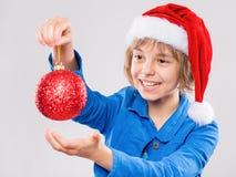 Niña en el sombrero de Santa Imagenes de archivo