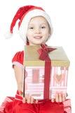 Niña en el sombrero de santa con el regalo en blanco Fotos de archivo libres de regalías