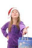 Niña en el sombrero de Santa en el fondo blanco Imágenes de archivo libres de regalías