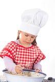 Niña en el traje del cocinero foto de archivo