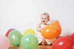 Niña en globos Foto de archivo libre de regalías