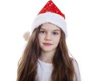 Niña en la Navidad aislada en blanco Fotos de archivo