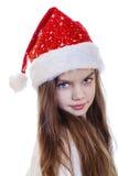 Niña en la Navidad aislada en blanco Foto de archivo libre de regalías