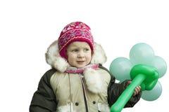 Niña en la ropa del invierno que parece triste En un fondo blanco Fotos de archivo libres de regalías