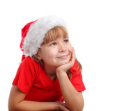 Niña en sombrero de la Navidad Imagenes de archivo