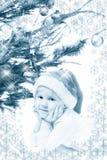 Niña en sombrero de la Navidad Imagen de archivo libre de regalías